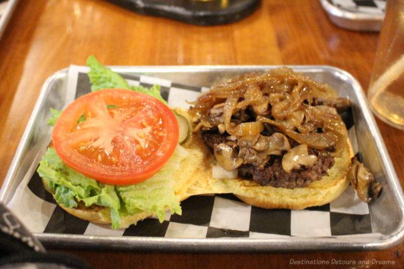 A burger with caramelized onions and fried mushrooms