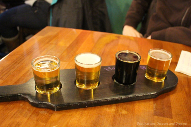 A flight of four craft beer samples