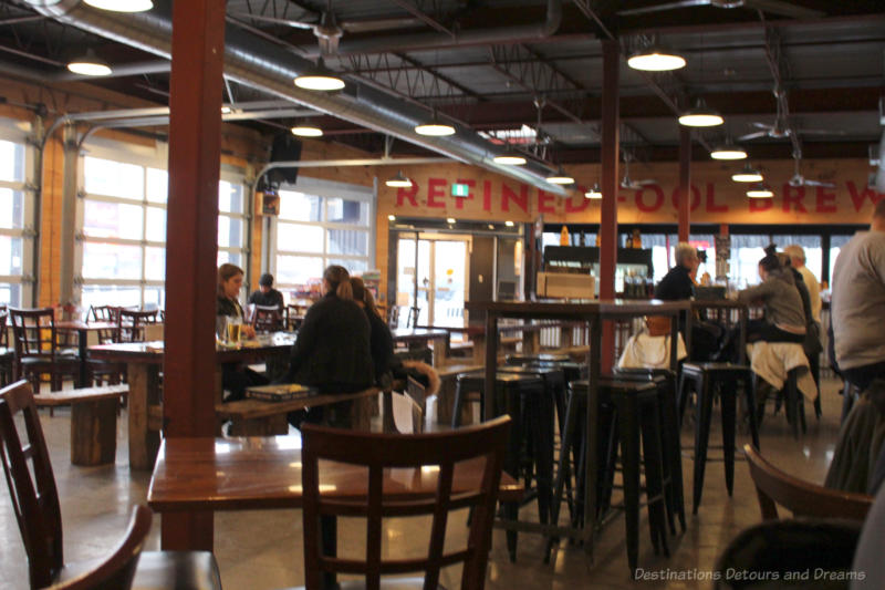 Tables in the industrial-looking space that is the Refined Fool taproom and Burger Rebellion restaurant in Sarnia