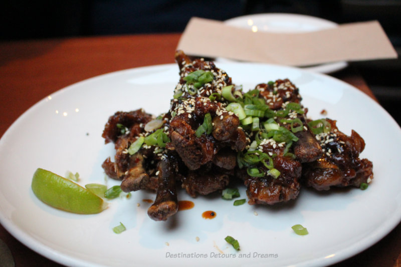 Duck wings topped with scallions at Mobys Pub