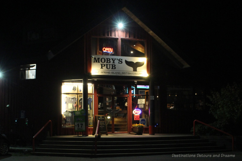 Entrance to Moby's Pub in the evening after dark