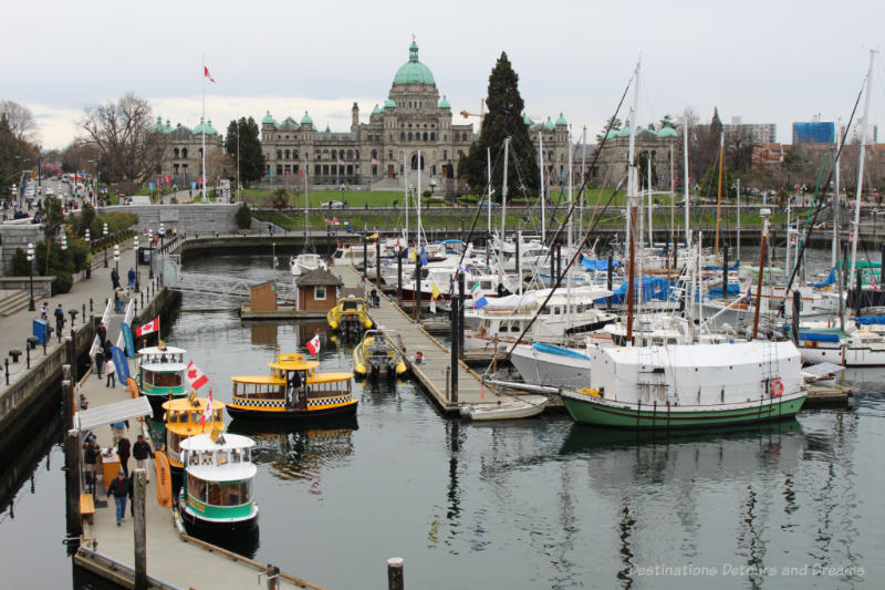 Boats in Victoria Inner Harbour with view of British Columbia Parliament Building in background