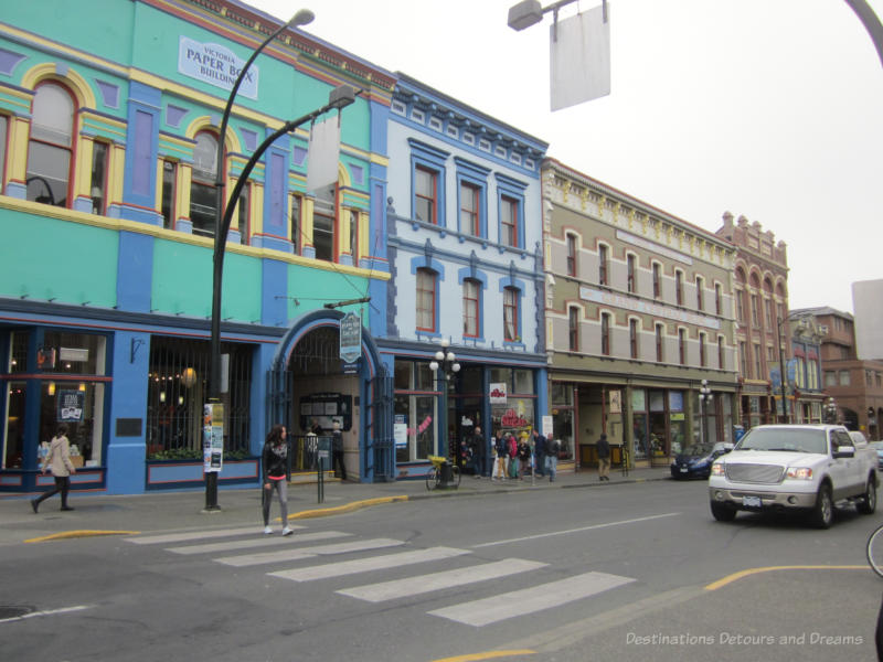 Blue, green, tan, and red buildings dating to the late 1800s in downtown Victoria