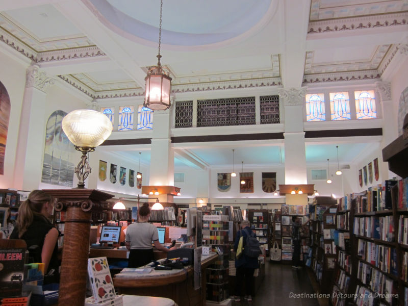 Book store interior with high ceilings and white pillars