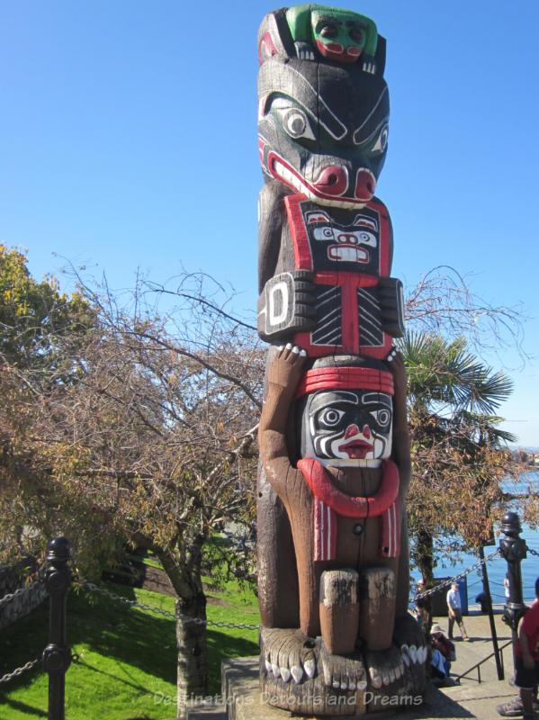 Totem pole alongside Victoria Inner Harbour