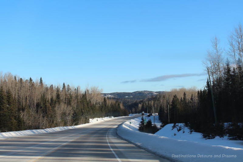 Canadian highway in winter with snow alongside the road