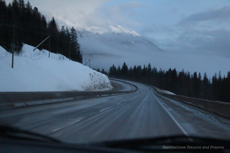Curving mountain highway as night begins to fall