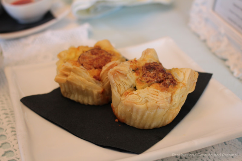 Two sausage, spinach, and feta mini-quiche in puff pastry