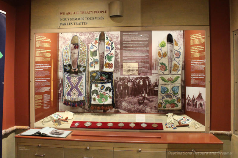 Exhibit at Manitoba Museum with artifacts and written information about treaties with First Nations peoples