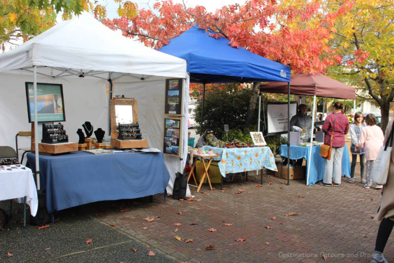 Canopy-covered booths at Salt Spring Island Saturday Market