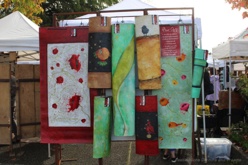 A collection of fabric art hanging at Salt Spring Island Saturday Market