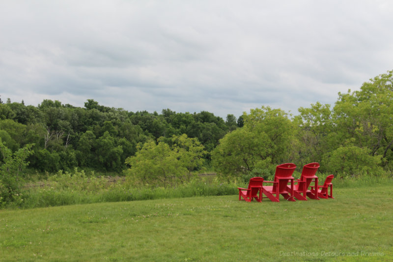 Red chairs looking out over river at Lower Fort Garry, Manitoba
