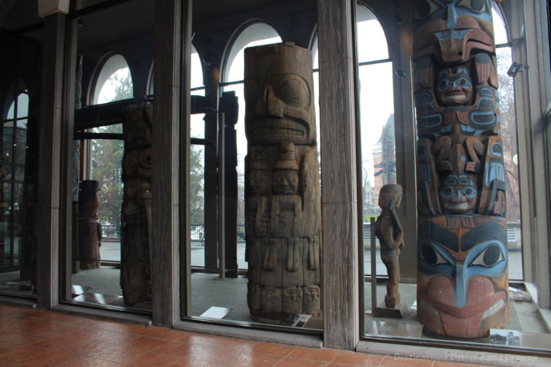 Totem poles inside the entrance of the Royal BC Museum in Victoria, British Columbia