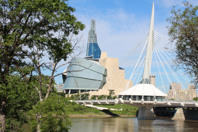 Canadian Museum for Human Rights alongside the Esplanade Riel pedestrian bridge in Winnipeg, Manitoba