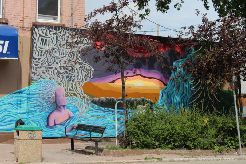 Multi-coloured stylized mural representing Canada's varied landscape