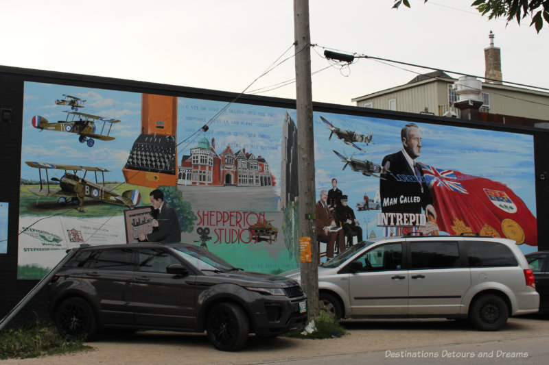 A mural showing a collage of items reflecting the life of Sir William Stephenson