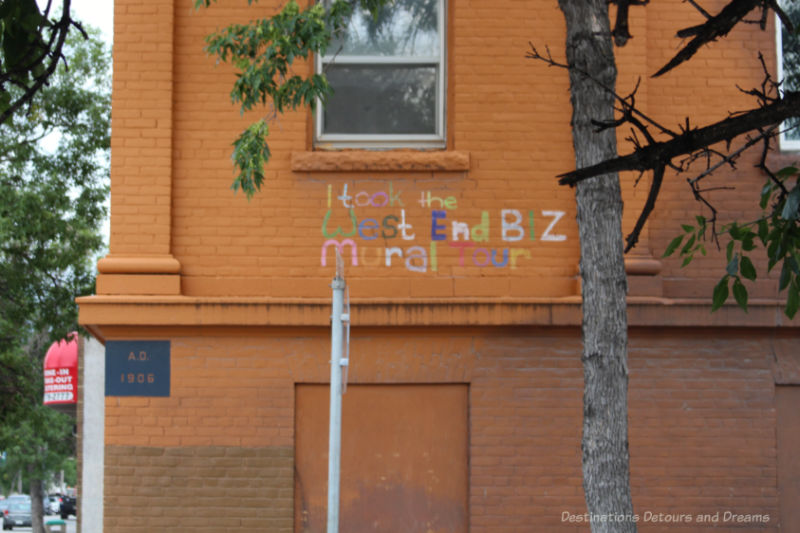 The words I took the West End BIZ mural tour written in many colours on the wall of a building
