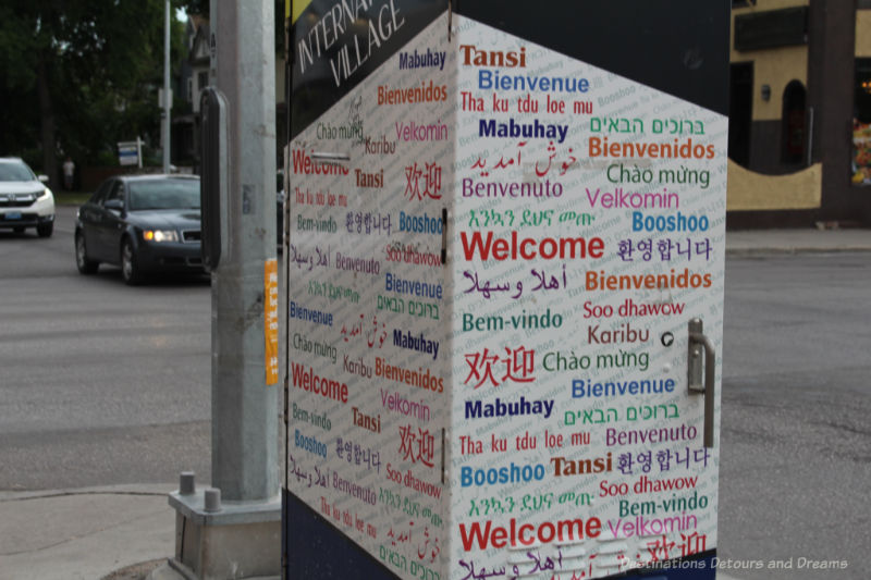 An electric box covered with words saying Welcome in different languages