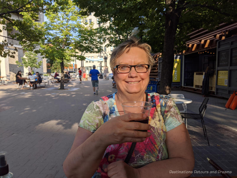 Donna enjoying a drink on the plaza patio