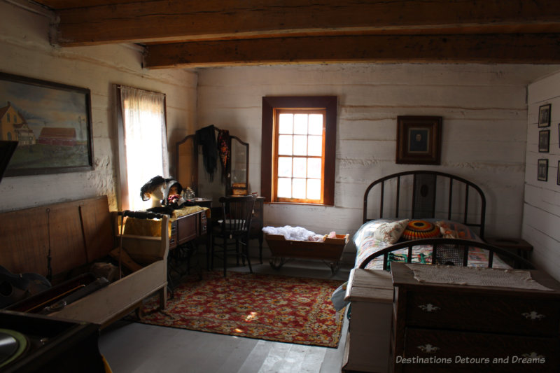 Bedroom inside a log home as per late 1800s