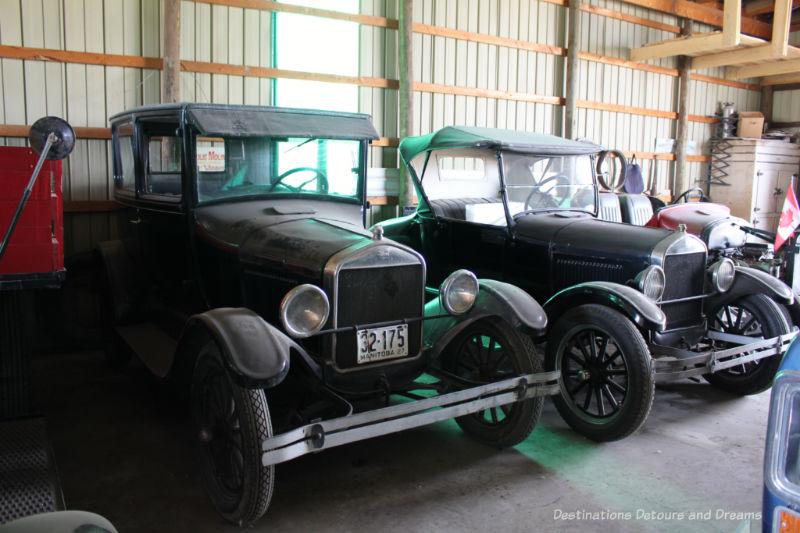 Two black vintage automobiles