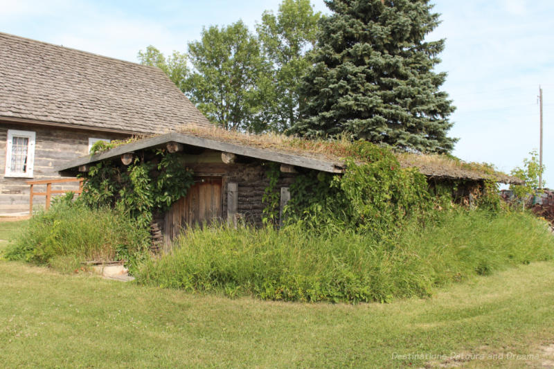 Sod house with foliage growing up the sides