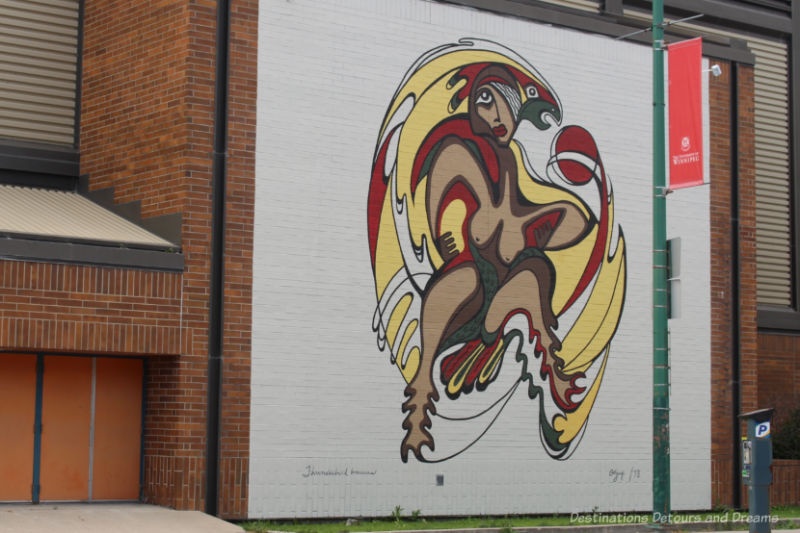 Tribute mural of The Thunderbird Woman by Daphne Odjig represents a figure of transformation, half-woman/half bird