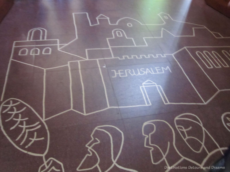 Markings on the floor of La Sagrada Família at the Passion Facade entrance symbolize the entrance to Jerusalem