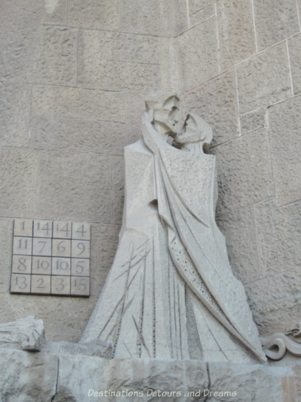 Sculpture on La Sagrada Família Passion Facade showing Peter's betrayal of Jesus and a number puzzle