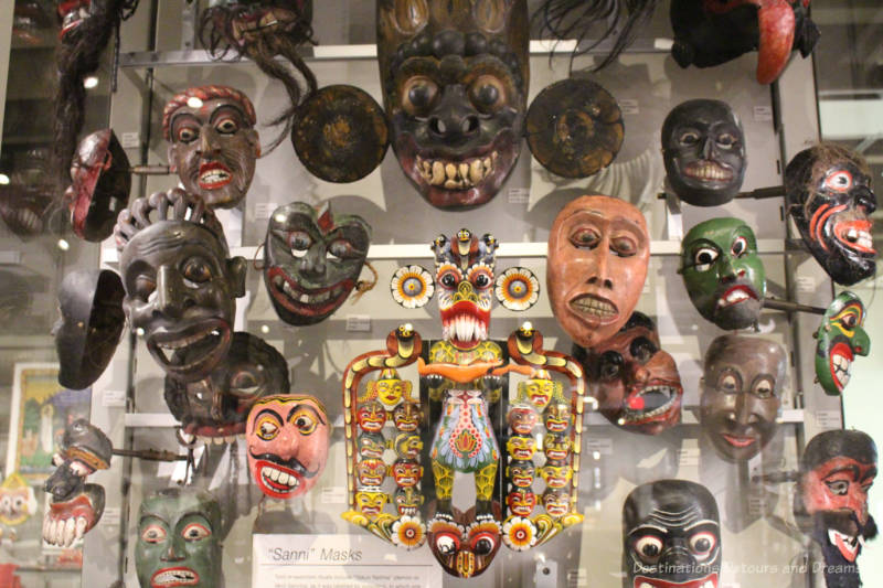 A collection if Sanni masks in a museum display at the Museum of Anthropology in Vancouver, British Columbia