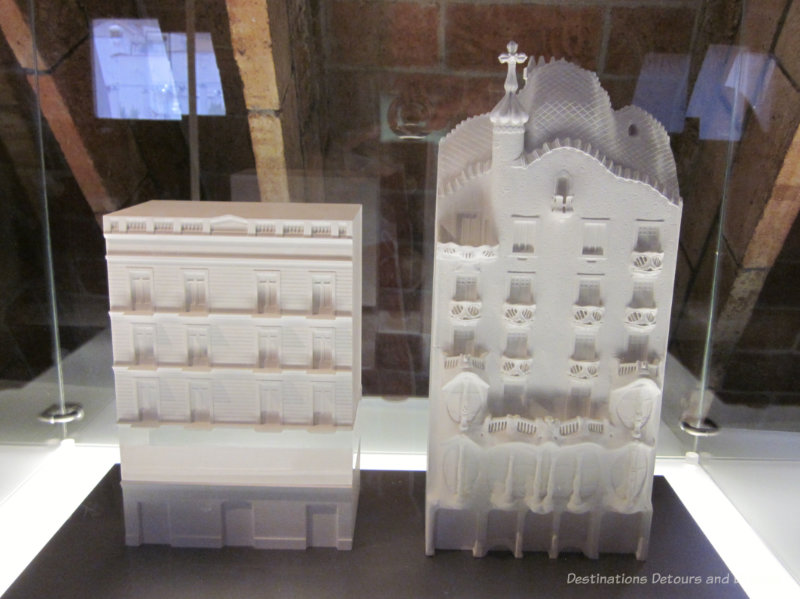 Two white models of multi-story Gaudí buildings