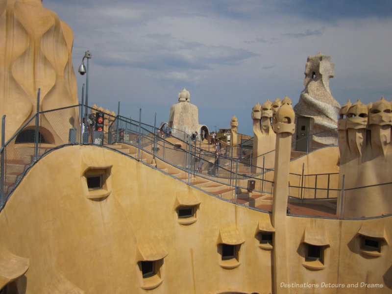 The undulating iconic rooftop of Casa Milà with it stone warriors and twisted chimneys