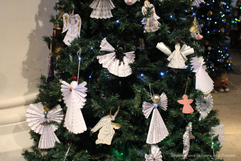 A Christmas tree decorated with paper angels