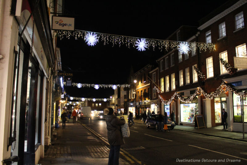 Garlands of Christmas lights strung across the street of an English town