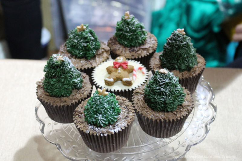 Chocolate cupcakes decorated with Christmas trees and a gingerbread man