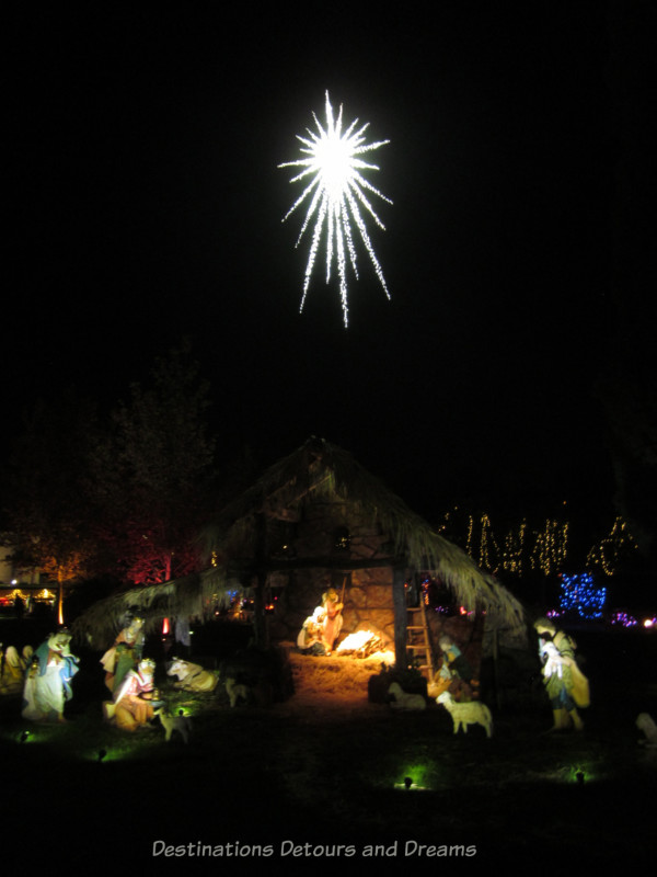 Nativity scene with lighted star above it