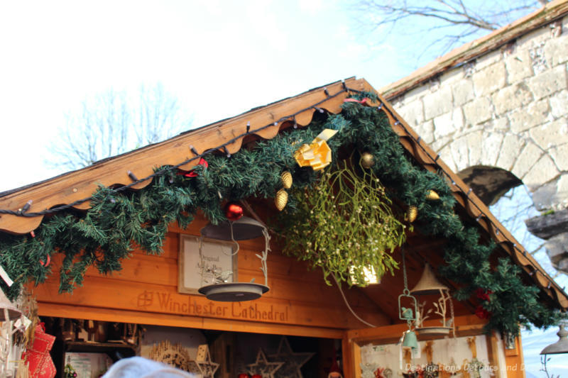 Garlands decorating the a-frame roof of wooden both at the Winchester Christmas Market