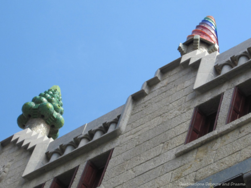 Cones of multi-coloured ceramic pieces covering the chimneys of Palau Güell