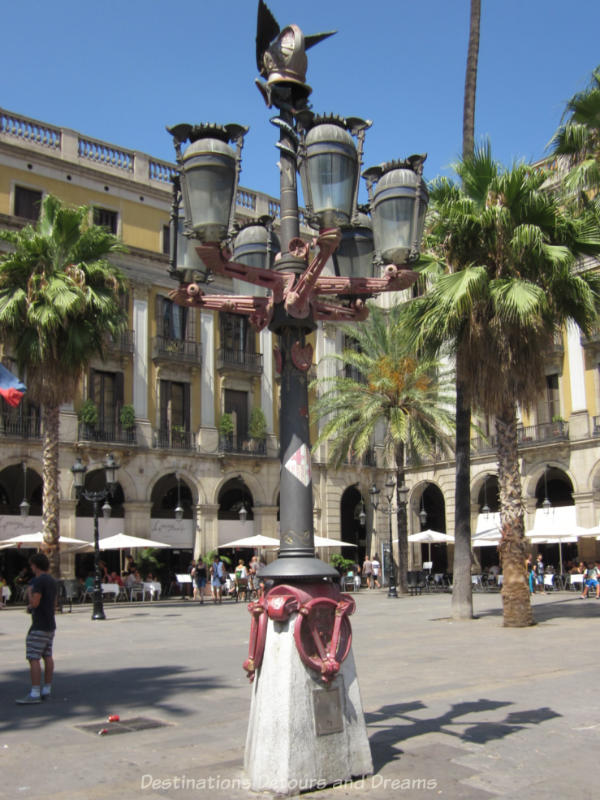 Gaudí lamp post with six arms for gas lights and crowned with a winged helmut