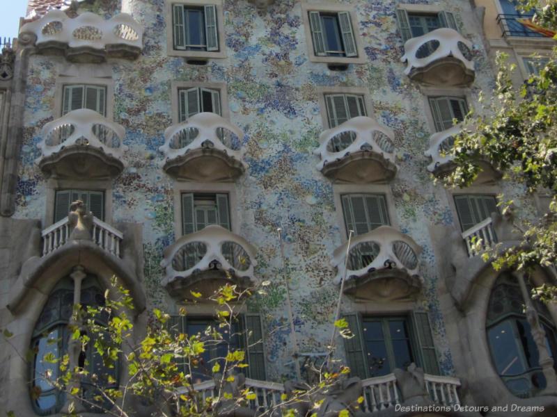 The multi-coloured facade and skeleton-like balcony railing of Gaudí's Casa Batlló