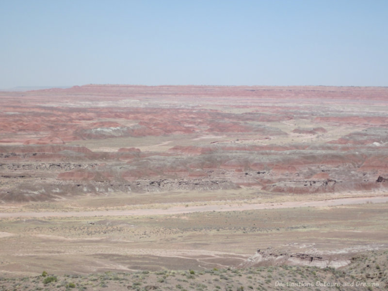 A vista in the Painted Desert showing pinks, reds, greens, and gray layers in the rock like colours brushed across a canvas
