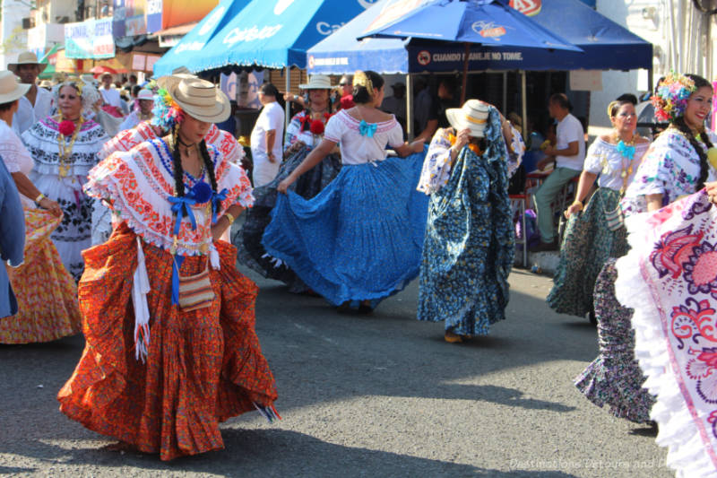 Woman in colourful polleras dancing in a street parade