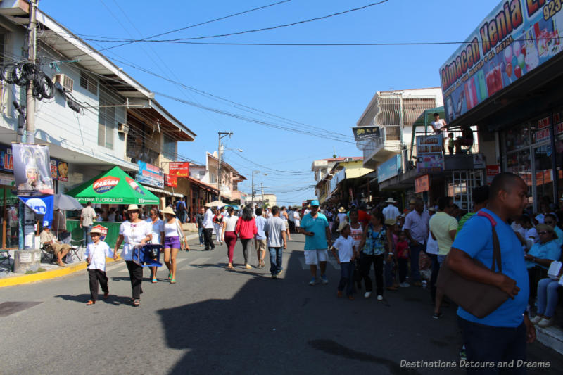 People filling the main street of Las Tablas, Panama as they wait for the Thousand Polleras Parade