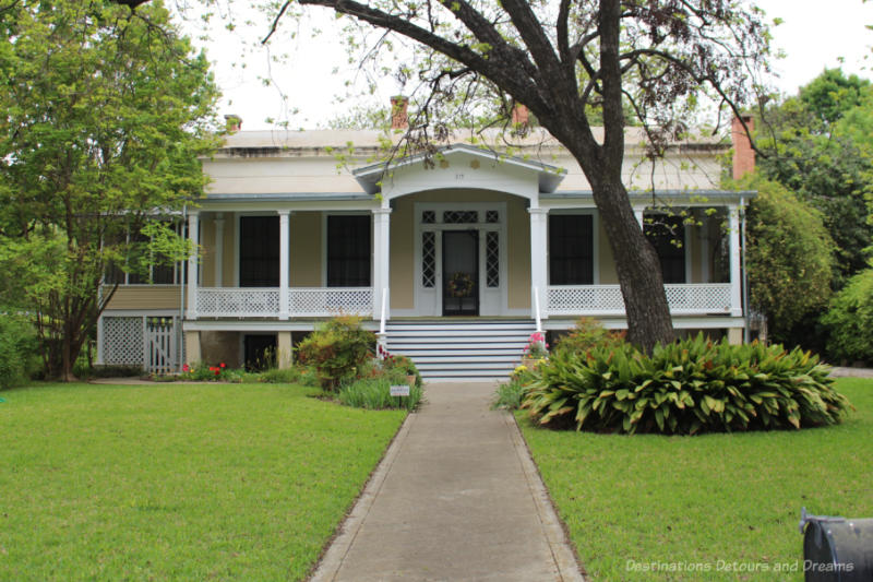 Gustave Blersch heritage house in San Antonio - Modified Greek raised cottage style house with half basement and a deep front veranda.