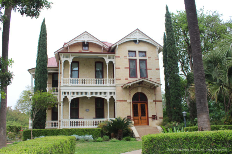 Victorian-style house constructed of yellow brick with red brick accents