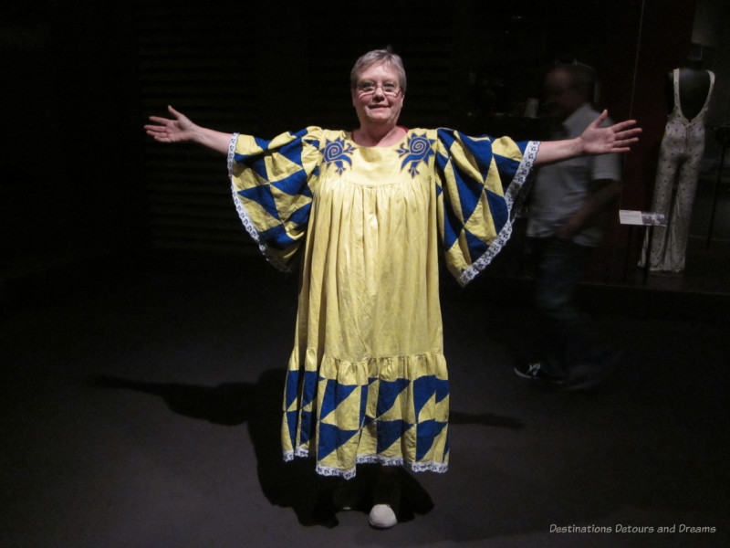 Theatre costume dress-up in gown of yellow and blue