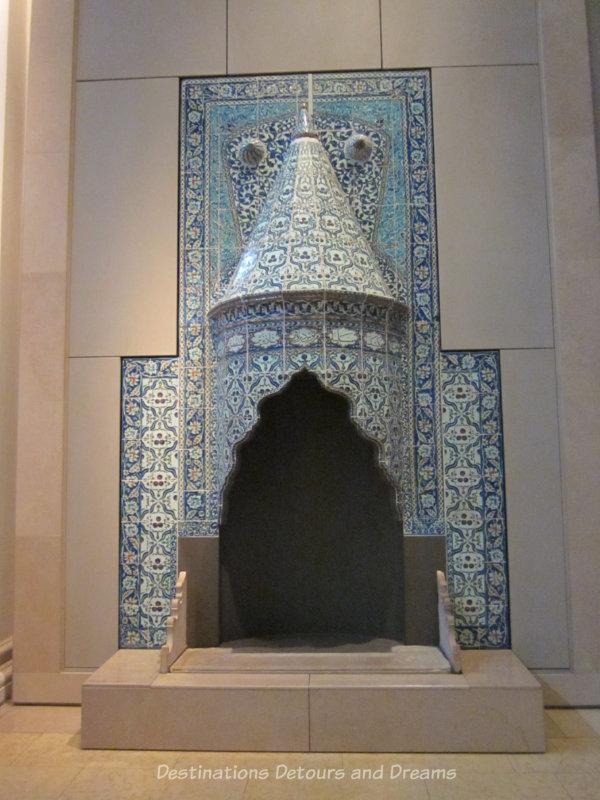 Blue tilework around a chimney on display at V&A