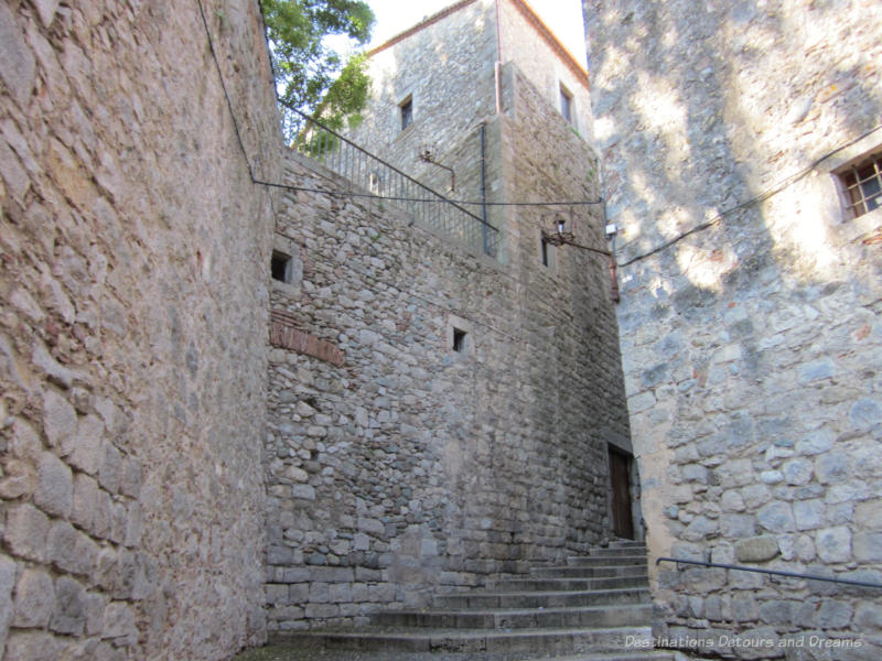 Ancient stone walls and steps of a fortress in Girona