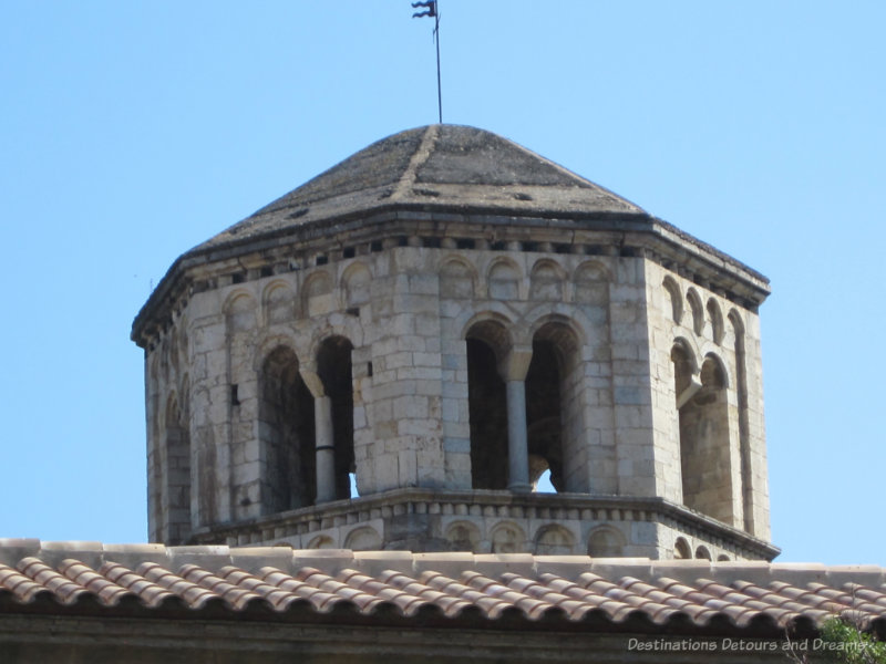 Octagonal stone bell tower atop a monastery in Girona