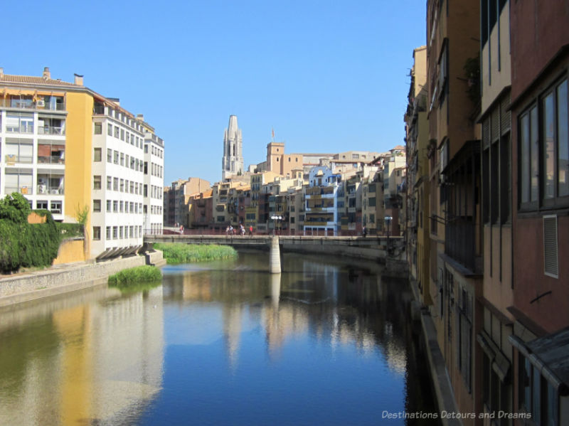 Buildings on either side of the Onyar River in Girona, Spain, with old town architecture on the right and new town on the left